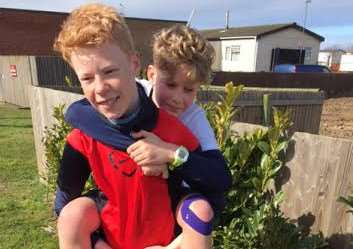 Olly Murdoch gets a helping hand from big brother Fin after his Sport Relief run