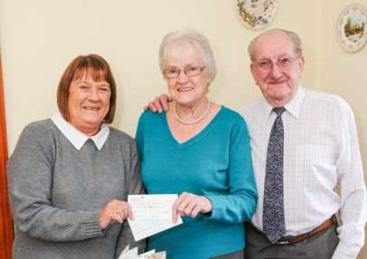 Diamond wedding couple Derek and Sylvia Day present cheques to Mary Dunn of the East Anglian Air Ambulance. ANL-141219-160131009