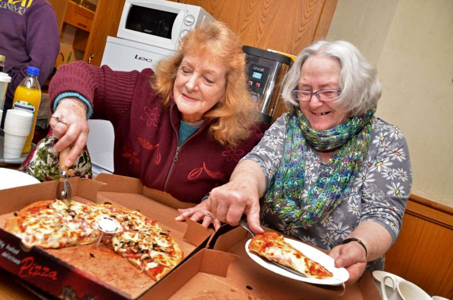 St Matthew's Church, Bridge Road, Sutton Bridge, junior race night,'Staphanie Wheeler and Janet Hammond serve pizza ANL-160123-211409001