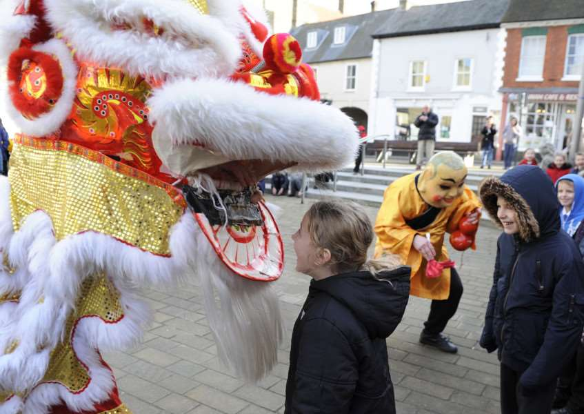 Chinese New Year Celebrations on the Town Square Downham Market, with pupils from some of the local schools enjoying the event. ANL-160802-132519009