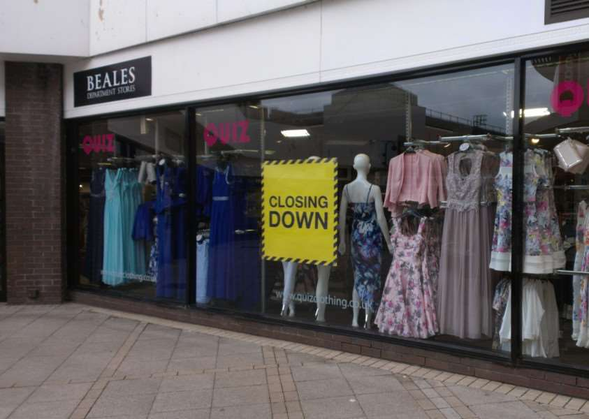Closing down signs at Lynn's Beales store