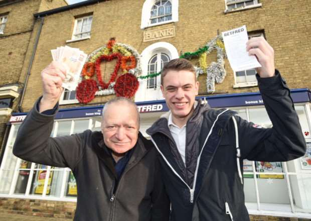 Lewis Sindle, who won �9,000 with a 10p bet, with his grandad John Dickerson outside the Btefred betting shop in Whittlesey
