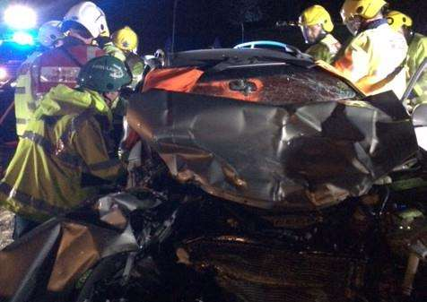 Fire crews cut a woman free from this car following the crash
