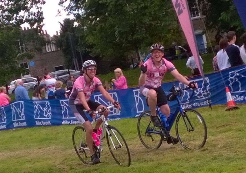 Sarah and Matthew Lamming cross the finish line of the 60-mile London to Cambridge bike ride in aid of Breast Cancer Now.