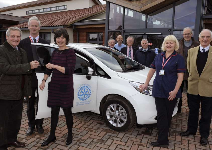 Downham Market Rotary Club handing over Nissan Note car to Norfolk Hospice Tapping House at Hillington.'From Left, Club President Peter Williams hands the keys to Lynsay Carter ( Norfolk Hospice Chief Executive), also in pic High Sheriff of Norfolk Nicholas Pratt, they are with other Rotary members and Nicola Ellis (Lead Nurse Day Therapy and Hospice at Home) ANL-161002-175217009