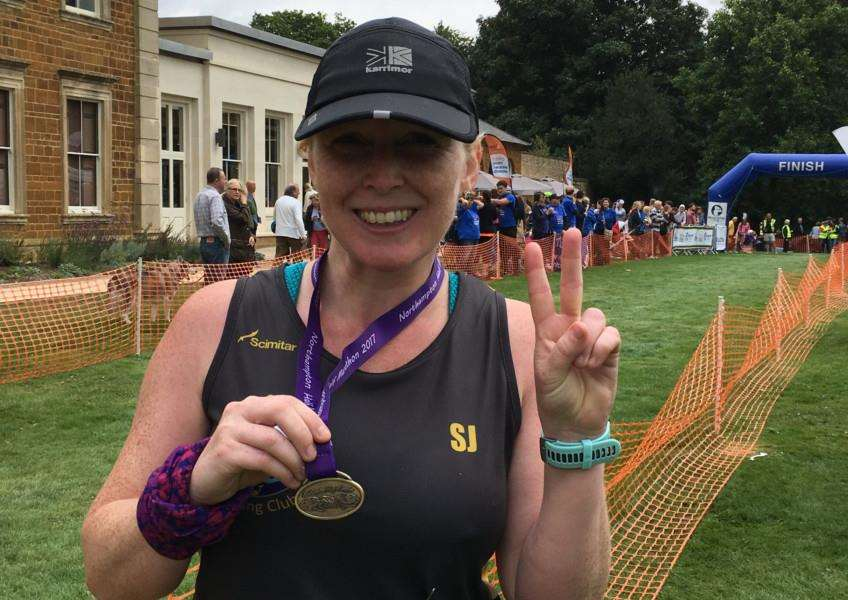 Sarah-Jane completing half marathon number 2 at Northampton