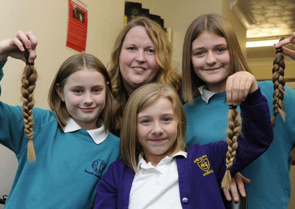 Wisbech sisters charity hair cut, LtoR, Ellie-Shea Williams, Kacey Williams, Shannon Williams, they are with Hairdresser and Reflections salon owner Kim Francis ANL-150803-093413009