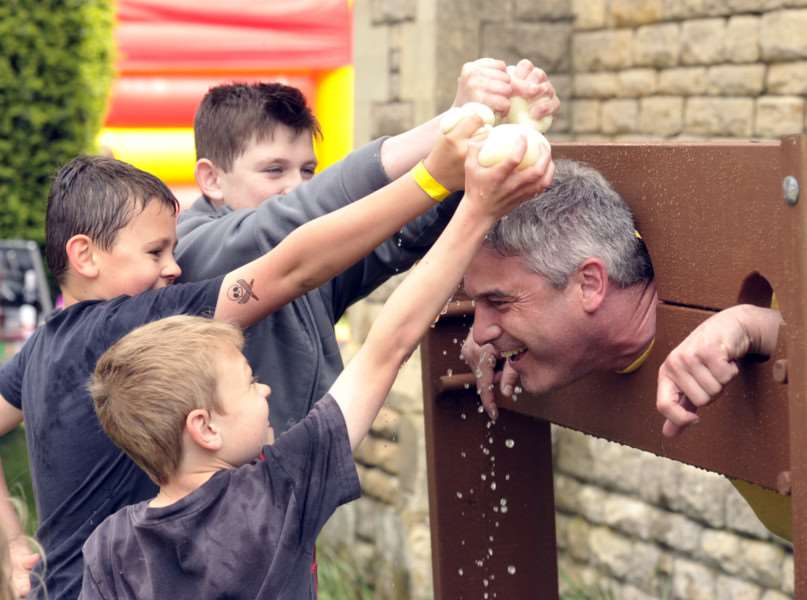 May day family fun day at St John's Church'Steve Barclay in the stocks ANL-150405-174831009