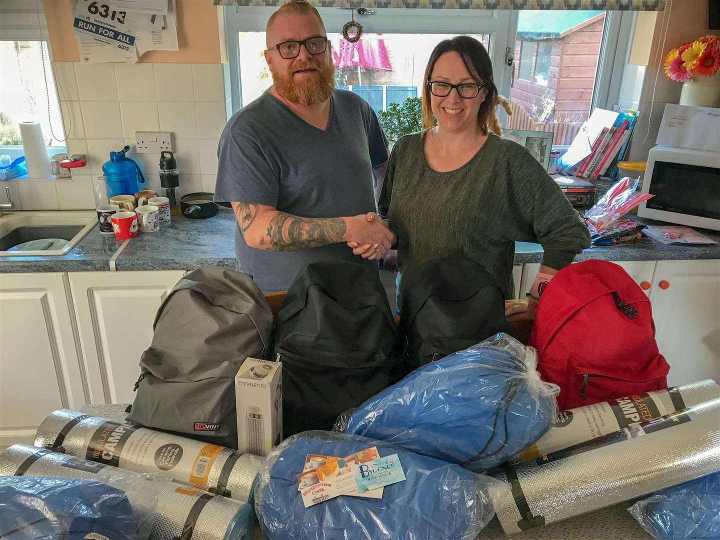 Spencer Neilly with Michelle Robinson from Wisbech Ladies Circle and some of the items donated for the homeless at the end of last year for the 50 Backpacks charity.