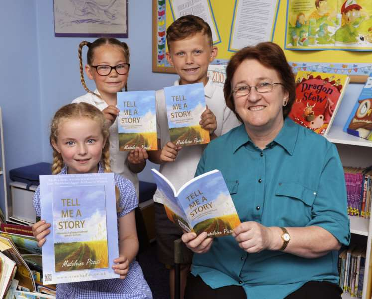 Former Leverington Academy pupil Madeleine Pizzuti, nee Missin, who emigrated to Australia 43 years ago, has returned with her new book about her childhood in the Fens. She is pictured with pupils, from left, Freya, Ivy and Lucas.