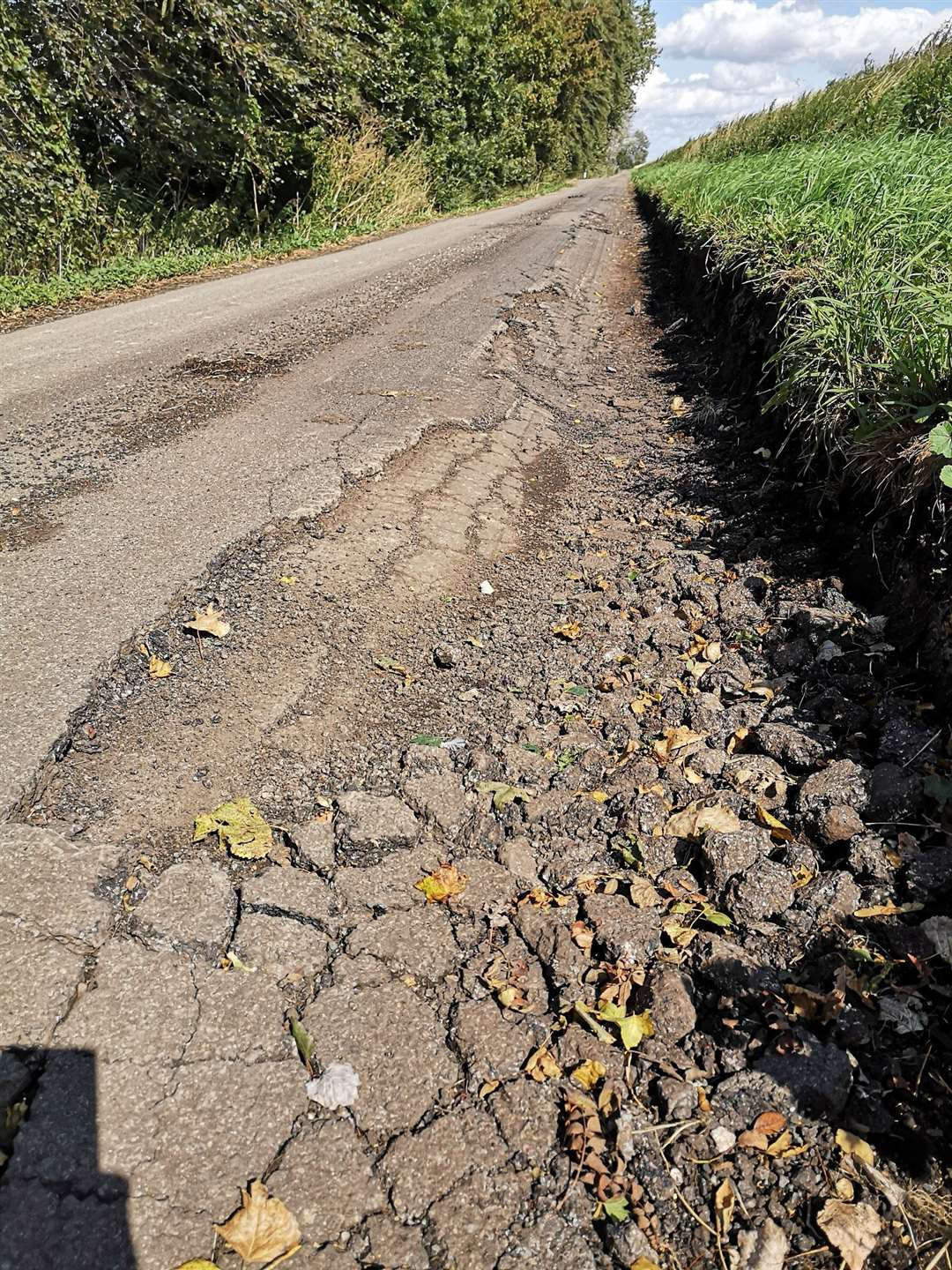 Heavy lorries have caused major damage to a minor village road. (16207167)