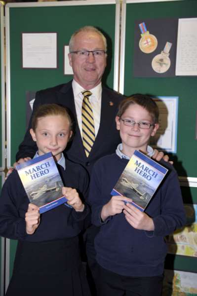 Mayor Mark Jamieson of the Sunshine Coast Council attending a visit to March Library to present books about Jim Hocking who saved the town of March. Jim Hocking was from the Sunshine Coast with pupils from Cavalry School who have been doing a project on Jim Hocking. 'Lily-Rose Keenoy 10 and Lewis Howe 10 ANL-150527-151003009