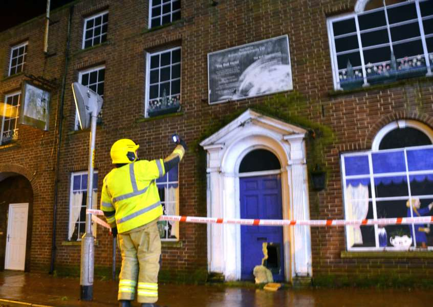 SAFETY HAZARD: A firefighter uses a thermal imaging camera to tackle a fire at the derelict Bull Hotel in Market Place, Long Sutton, on Friday. Photo by Tim Wilson. SG060117-207TW.