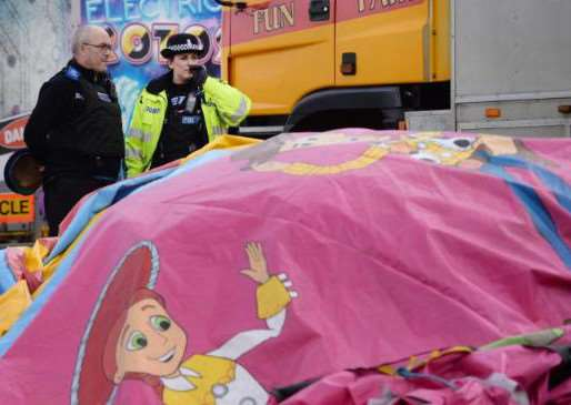 Officers on site at the fun fair. Photo: PA