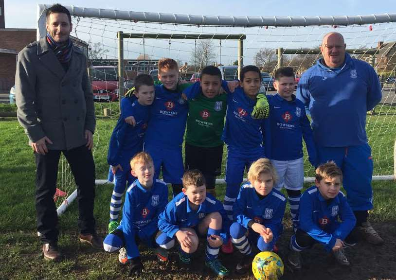 March Soccer School Under 10's were presented a smart new team strip by Chris Ringham, Practice Manager at Bowsers Solicitors