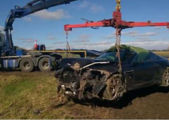 The Aston Martin Vantage is recovered by police