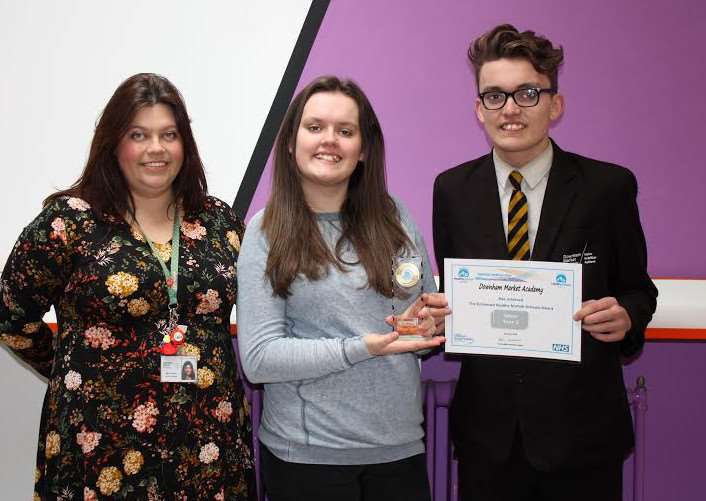 Danielle and Reece Peers-Holland with staff member Nadine Taylor, holding the Silver Award.