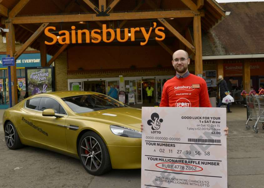 This gold Aston Martin and giant lottery ticket toured Cambirdgeshire last month looking for the winner, but without success.
