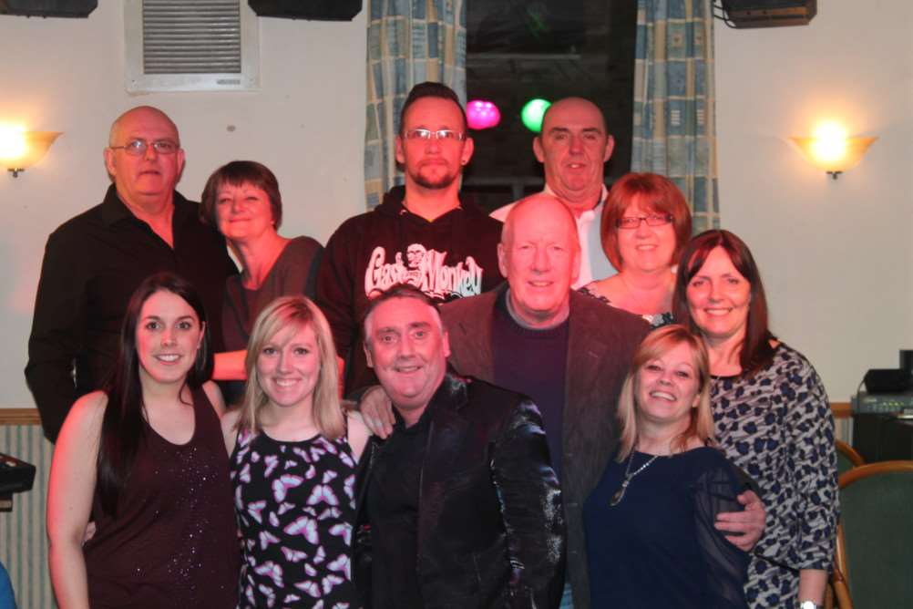Family members and friends with Katie Perry, front left, who held a cabaret fundraiser in Chatteris in aid of Alzheimer's Society. ANL-150326-093214001