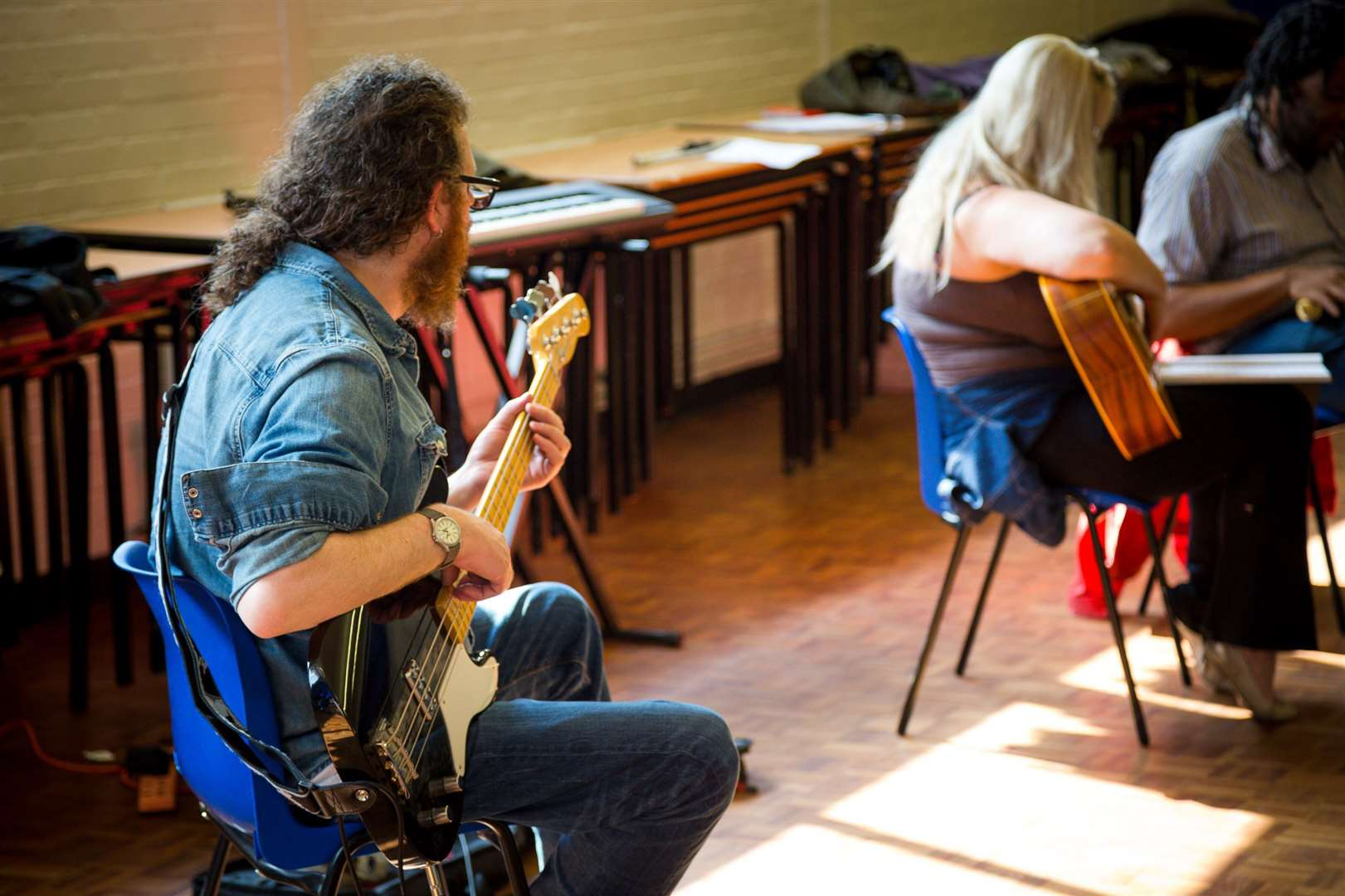 Guitar lessons are just one of a nubmer of free arts courses on offer to adults. (24743095)