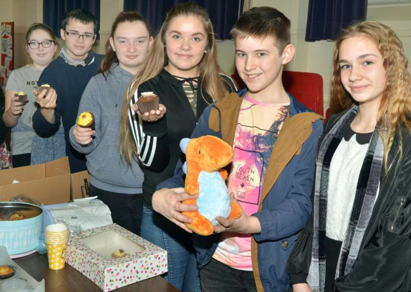 CHILDREN IN NEED Students run a cake stall to fundraise at Spalding Academy. Photo by Tim Wilson. SG171117-130TW.