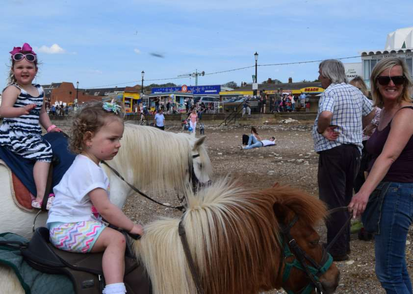 Ruby, 18 months, and Lily, nearly 4, on the ponies with Trudy Desborough. ANL-160705-160330001