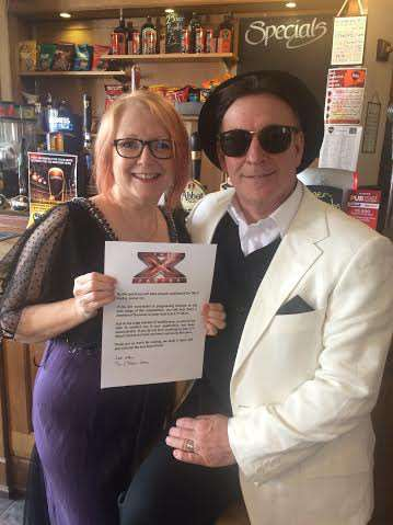 Paul Hayward and Saly Rose with their X Factor invitation