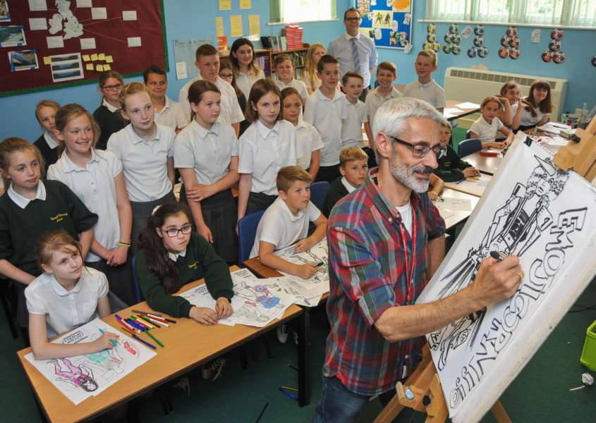 Artist Andy Scordellis from Hilgay works with pupils at Upwell Community Primary School on the 'Heroes and Villains' theme. ANL-150406-143900009