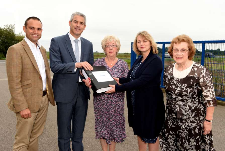 The Friends of Doddington Hospital present a petition to the CCG. Pictured, from left, are: Dr Gary Howsam, MP Steve Barclay, Friends member Maureen Coker, chief executive of the CCG Tracey Dowling, and Friends member Mary Barrett.