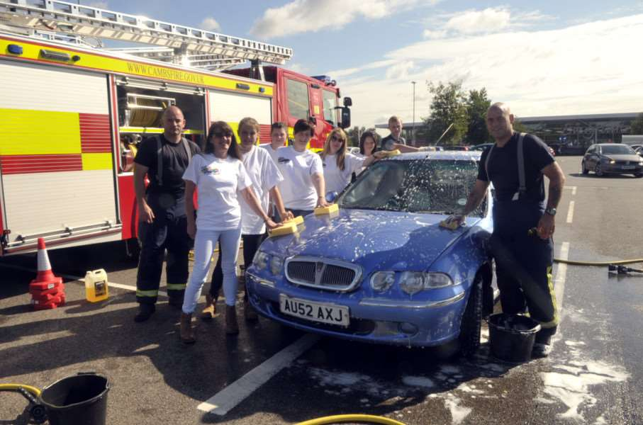 March Firefighters doing a car wash for firefighters charity and welcome 2 our world at Tesco in March Contact Sherie Paris ANL-140817-113341009