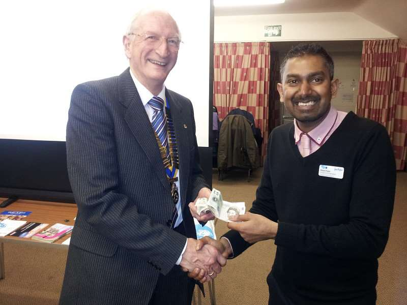 Chatteris Rotary Club president Donald Ashmore presents the proceeds of a raffle to Nilesh Patel, from the Sue Ryder home in Peterborough.