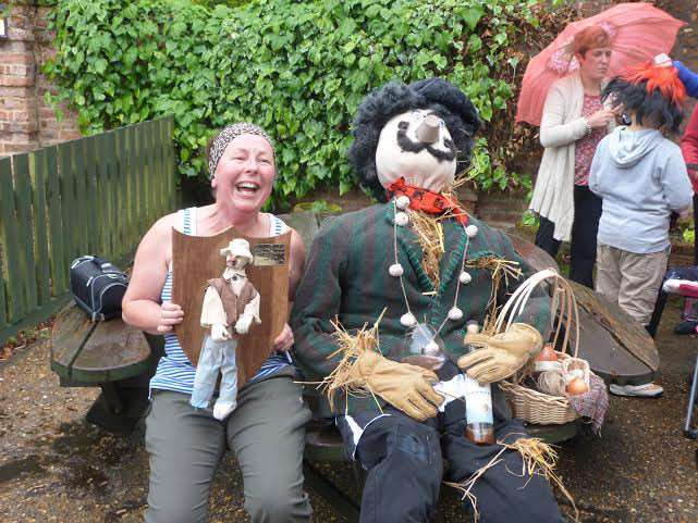 Mrs Christine Brennan with her winning entry in the scarecrow competition at the Elm and Friday Bridge yard sale event