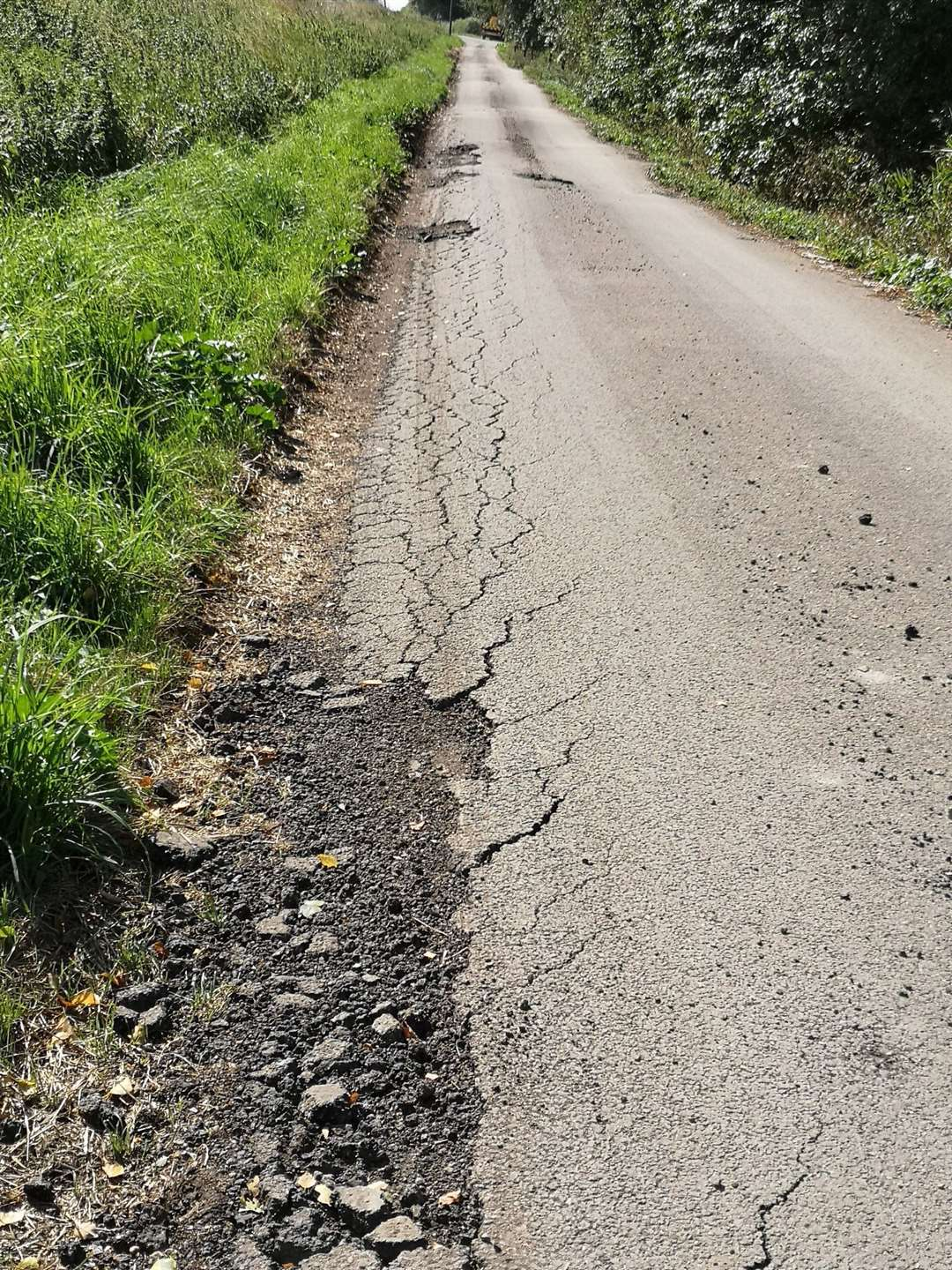 Heavy lorries have caused major damage to a minor village road. (16207174)