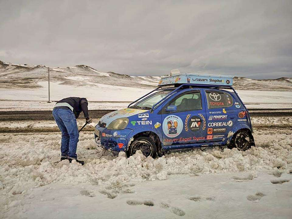 Dan and Dave had to dig Larry the Yaris out of snow in Mongolia. (4583441)