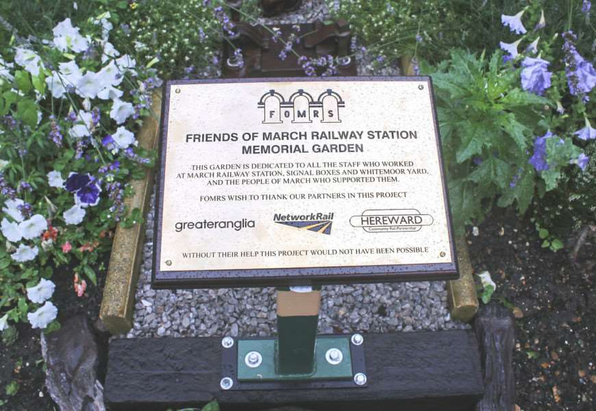 March mayor Kim French officially unveils a memorial garden at the town's railway station to remember war dead.