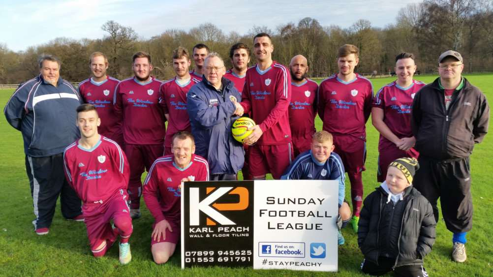 Team of the Month is sponsored by Karl Peach Wall & Floor Tiling.'The team in claret are Elm and won it in November and are presented their ball by League Chairman Nigel Moulton.