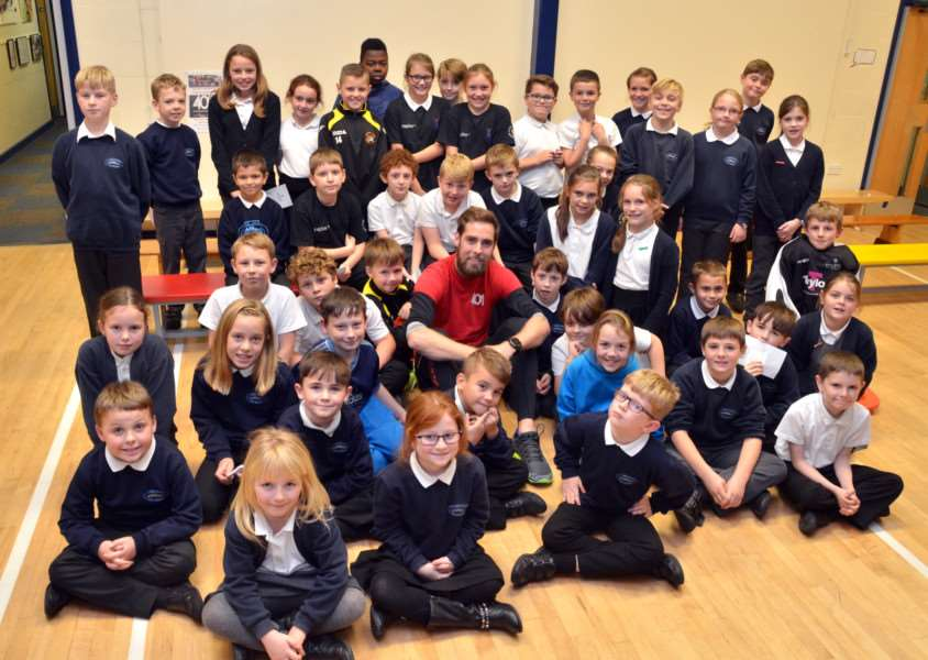 LOTTERY FUNDING: Pupils at Long Sutton Primary School, which has won nearly �10,000 of Big Lottery Fund cash, with multiple marathon runner Ben Smith. Photo by Tim Wilson. SG211116-118TW.