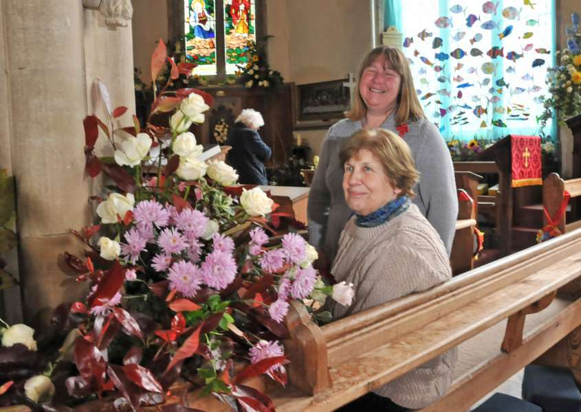 Pauline Stebbings at Sutton St James Parish Church 'with fellow churchwarden Sally Clifton at the village's annual flower festival.' Photo by Tim Wilson. SG240513-130TW. www.spaldingtoday.co.uk/buyaphoto