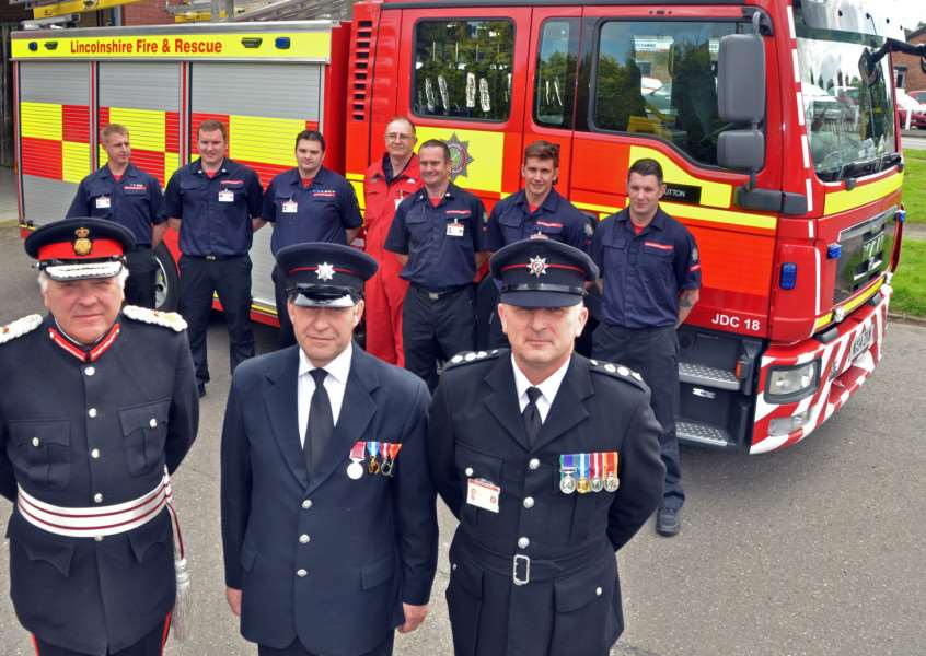 Richard King BEM (centre), watch manager at Long Sutton Fire Station, with firefighters, Lord Lieutenant of Lincolnshire Toby Dennis and Deputy Divisional Manager for Lincolnshire Fire and Rescue, Pete Wiles. Photo by Tim Wilson.