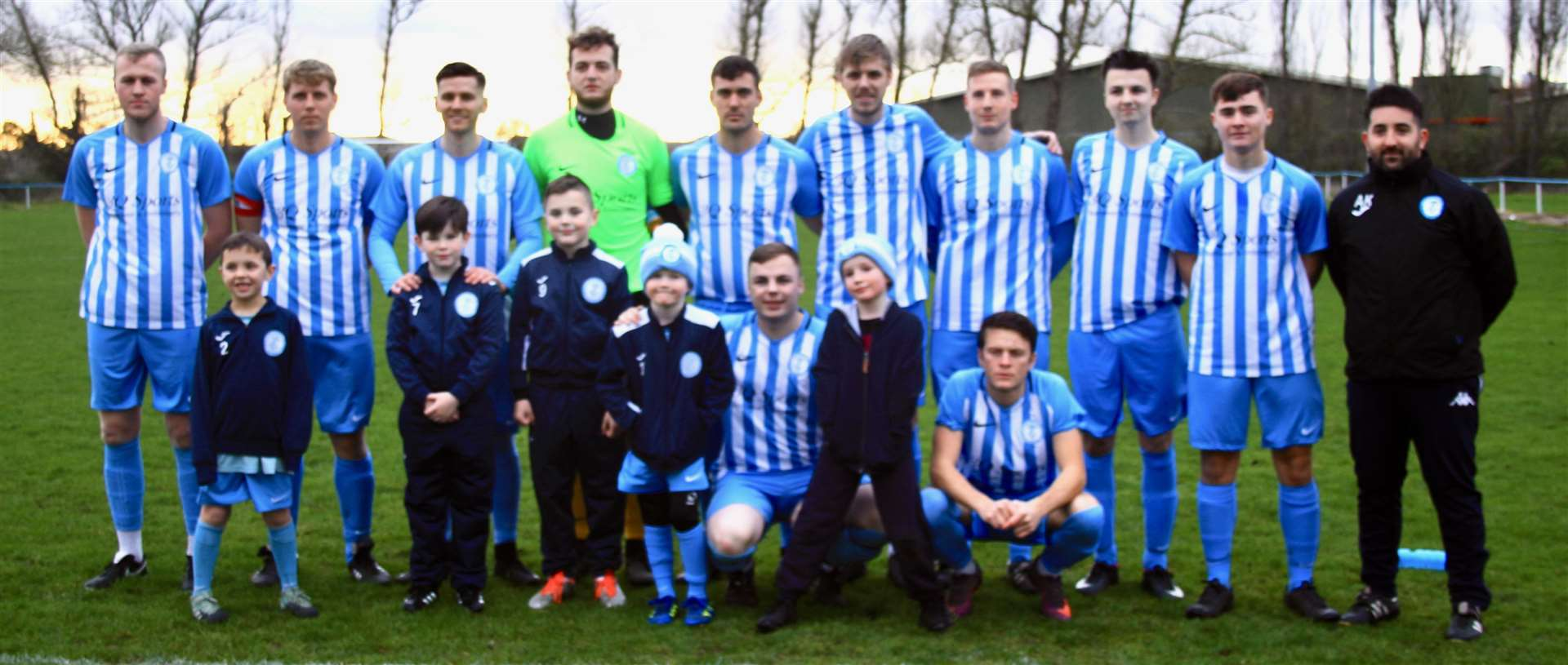 Chatteris Town - First Team 2018-19 (Back, from left: Ash Blanchflower, Simon Howard, Gary Smith, Jordan Packi, Stuart Porter, Ben Matthews, Scott Fisher, Mark Rayment, Brandon Ransome, Alex Kaufman)(Front, from left: Josh Dodman with Chatteris Town Young Lilies Under 8's mascots, Jack Saunders. (6492426)