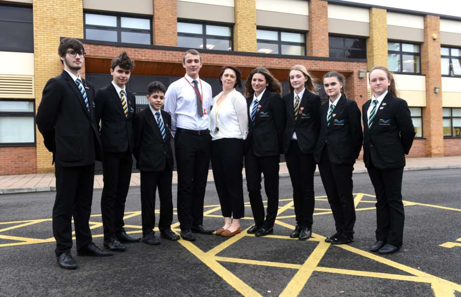 Imogen Newell with some of the pupils from diverse backgrounds to go with a piece on the Wisbech being second least integrated town in the country'left to right back 'Harry Smith (Portuguese), Emanuel Malaquias (Portuguese), Gabriel Ferreira (Portuguese), Jonas Lotuza (Lithuanian), Imogen Newell EAL leader, Alicia Baghdouyan (French), Jade Lartillier (French), Anastasija Kurisko (Russian) and Justina Kakstyte (Lithuanian) ANL-160102-135445009