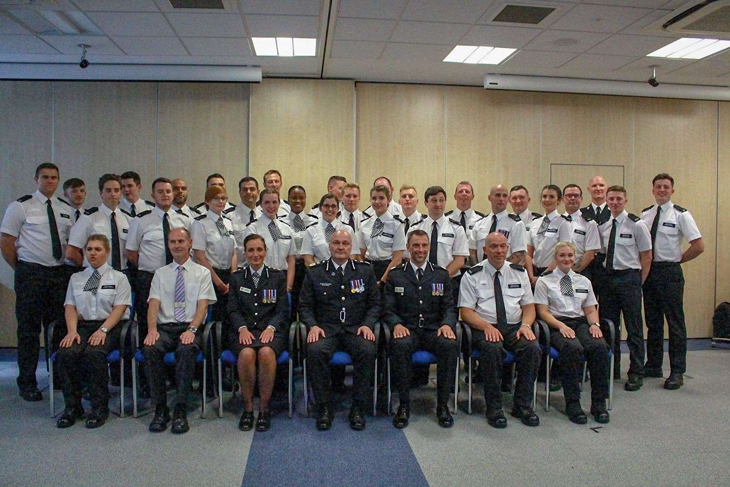 The 28 new police recruits with the county's senior officers at their passing out ceremony. (13391201)