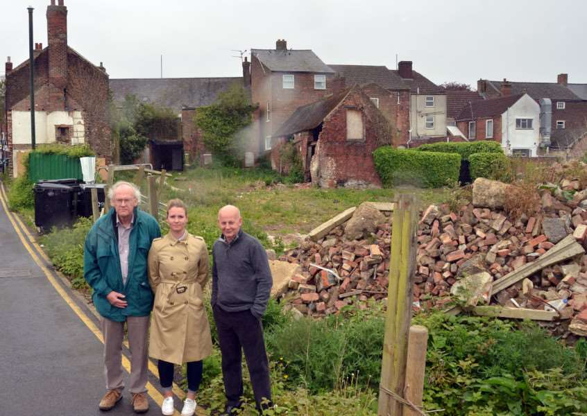 Tim Machine, chairman of Long Sutton and District Civic Society, with South Holland District Council members Laura Eldridge and Jack Tyrrell on the derelict site at the back of the Bull Hotel, Long Sutton. Photo by Tim Wilson. SG150517-153TW.