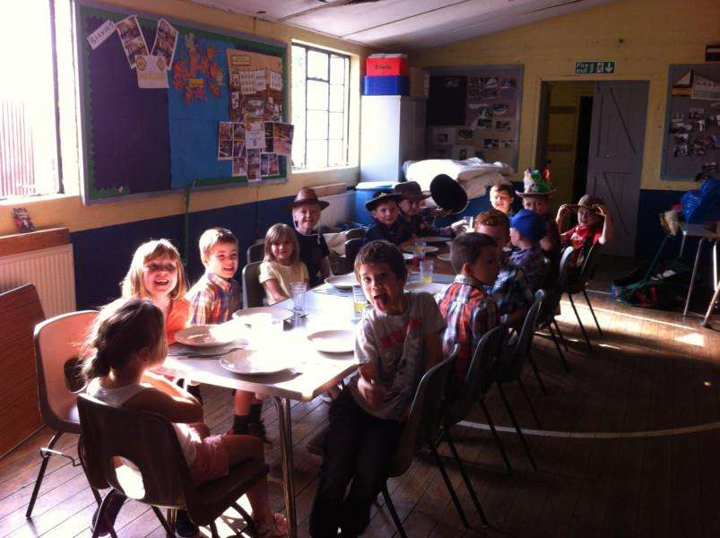 The 1st March Beavers enjoy breakfast after a Cowboys and Indian themed sleepover.