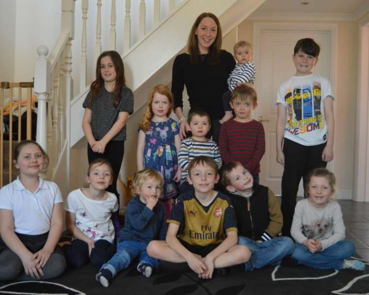 Childminder Emma Bishop, pictured with some of the children she looks after, has been rated as 'outstanding' by Ofsted.