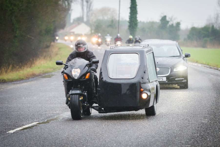 Motorcyle procession for the funeral of Russell Coombes makes its way from Marshland St James to Mintlyn Crematorium passing through King's Lynn. ANL-160122-182724009