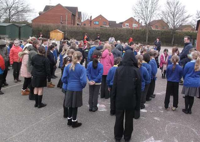 Anthony Curton Primary children observe a minute's silence.