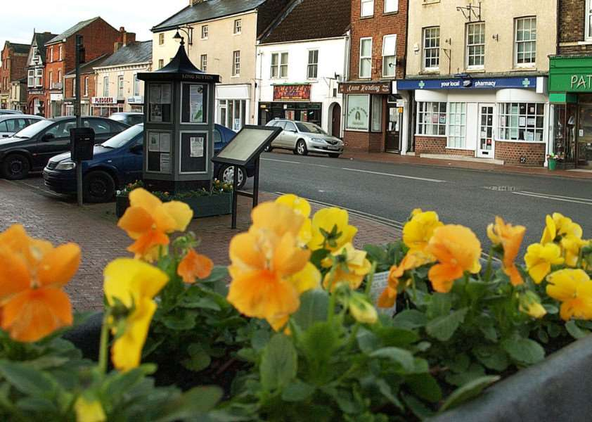 The ornamental street sign in Market Place, Long Sutton, which the parish council could look to reinstate there.''Photo (TIM WILSON): SG110112-123TW.